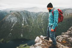 Adventurer travel man hiking in mountains alone Royalty Free Stock Photography