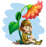An adventurer under the shade of a flower Stock Photography