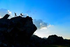 Adventurers at the top of the rock. Adventurer climbers;adventurers at the top of the rock Stock Photos
