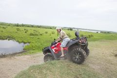 Tourists on all-terrain vehicles. On ATV Stock Images