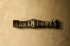 ADVENTURES - close-up of grungy vintage typeset word on metal backdrop Royalty Free Stock Image