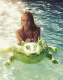 Adventures of girl on crocodile. adventures and travelling of girl with inflatable crocodile royalty free stock photo
