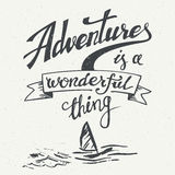 Adventures is a wonderful thing vintage poster. Adventures is a wonderful thing. Hand drawn typographic design for t-shirts, posters and greeting cards in Stock Photos