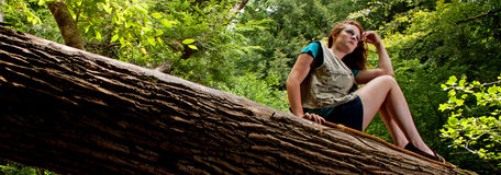 Adventuress on a log Royalty Free Stock Photo