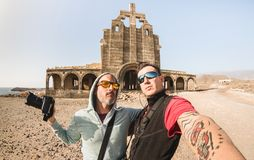 Adventurous best friends taking selfie at abandoned place in Tenerife. Wanderlust travel lifestyle - Trip together around the world as alternative lifestyle stock images