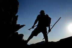 Adventurous climber silhouette&mountains. Discovery and fun; Adventurous climber silhouette Stock Photo