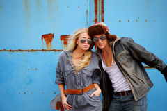 Adventurous couple. Attractive adventurous couple, against grunge metal wall background Stock Photography