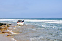 Adventurous Driving Along the Beach Stock Photography