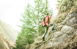 Adventurous explorer trekking and climbing on french alps Royalty Free Stock Photos