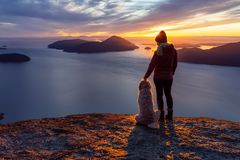 Free Adventurous Girl Hiking On Top Of A Mountain With A Dog Royalty Free Stock Photo - 167580555