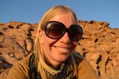 Adventurous hiker woman in desert grand canyon. Smiling adventurous female hiker in desert canyon Stock Photo
