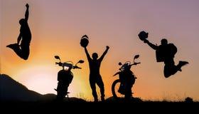 Adventurous motorcycle team. Adventurous motorcyclist team & motorcyclists silhouette Stock Images