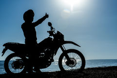 Adventurous motorcyclist Royalty Free Stock Image