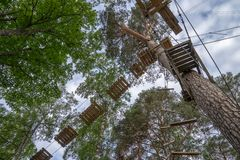 Adventurous outdoor activity at an elevated aerial forest climbing challenge course. Adventurous outdoor activity at an aerial forest climbing challenge course Stock Images