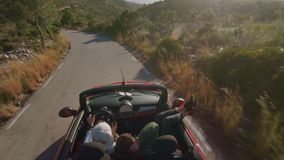 Traveling in convertible car for life. Adventurous wanderlust lovers and seekers, travellers and tourist, inspiring social media couple travel around beautiful stock footage