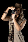 Adventurous woman on safari. Beautiful woman venturing into the exploration of a safari Stock Images