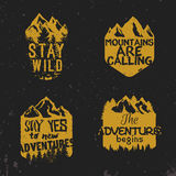 Advenutre emblem. Set of vintage wilderness badges with mountains and trees silhouettes. inspirational outdoor quotes, motivational phrases. Stay wild, mountains Stock Image