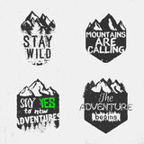 Advenutre emblem. Set of wilderness badges with mountains and trees silhouettes. inspirational outdoor quotes, motivational phrases. Stay wild, mountains are Royalty Free Stock Image