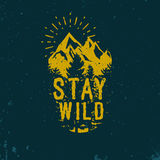 Advenutre emblem. Stay wild logotype in vintage style Royalty Free Stock Photography