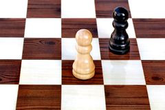 Adversary chess pawns Stock Images