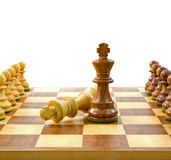 Adversary King Chess Pieces. On a chess board with pawns, on white background Stock Images