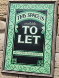 Advert. Ising space to let sign on outside wall Royalty Free Stock Image
