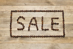 Advert sale made of coffee beans Stock Photography