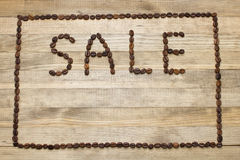Advert sale made of coffee beans Royalty Free Stock Image