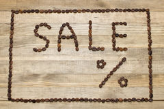 Advert sale made of coffee beans Royalty Free Stock Images