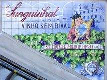 Wine advertisement on tiles in Porto, Portugal royalty free stock photo