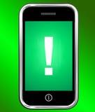 Advertencia de Mark On Phone Shows Attention de la exclamación Foto de archivo