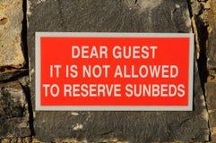 Advertencia de Sunbeds Fotografía de archivo libre de regalías