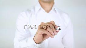 Advertencia final, escritura del hombre sobre el vidrio Imagen de archivo libre de regalías