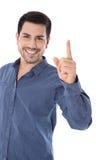 Advertencia: hombre sonriente aislado que señala con su índice Foto de archivo