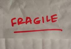 Advertencia manuscrita frágil Imágenes de archivo libres de regalías
