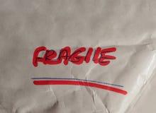 Advertencia manuscrita frágil Imagen de archivo libre de regalías