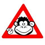 Advertencia - mono en una rueda imagen de archivo