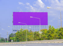 Advertise billboards beside road Stock Images