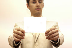 Advertise blank card. Man in suit holding blank card for advertise stock image