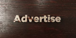 Advertise - grungy wooden headline on Maple  - 3D rendered royalty free stock image Royalty Free Stock Images