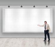 Advertise here. Concept with copyspace - friendly businessman inviting you royalty free stock photos