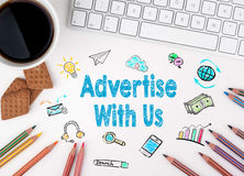 Advertise With Us, Business concept. White office desk stock photos