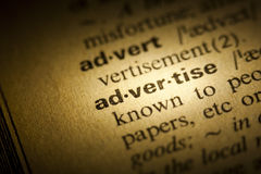 Advertise. Word Advertise in a dictionary Stock Image