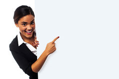 Advertise your business here. Place your business ad here. Woman pointing at blank whiteboard Stock Photo