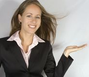 Advertisement. What's in her hand? She's pretty happy about it stock photography
