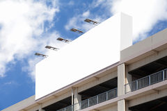 Advertisement  billboard on car parking building Royalty Free Stock Photo