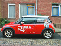 Advertisement on a car that stands in the street Stock Images