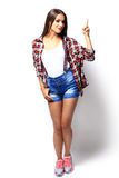 Advertisement concept - attractive young woman in casual clothes Royalty Free Stock Photo