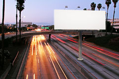 Advertisement concept. Front view of blank white billboard in nighttime city. Advertisement concept. Mock up, 3D Rendering royalty free stock images