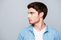 Advertisement concept, side view half face profile with copy spa. Ce of perfect, attractive man in casual outfit standing over gray background stock photo